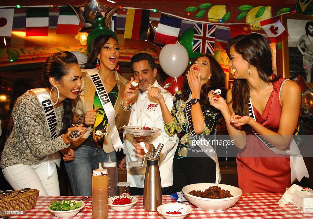 Miss Cayman Islands Lindsay Japal, Miss Jamaica Chantal Zaky, Chef Stuart Leitner, Miss Honduras Jennifer Andrade and Miss Switzerland Alina Buchschacher appear at the Buca di Beppo Italian Restaurant on December 6, 2012 in Las Vegas, Nevada.