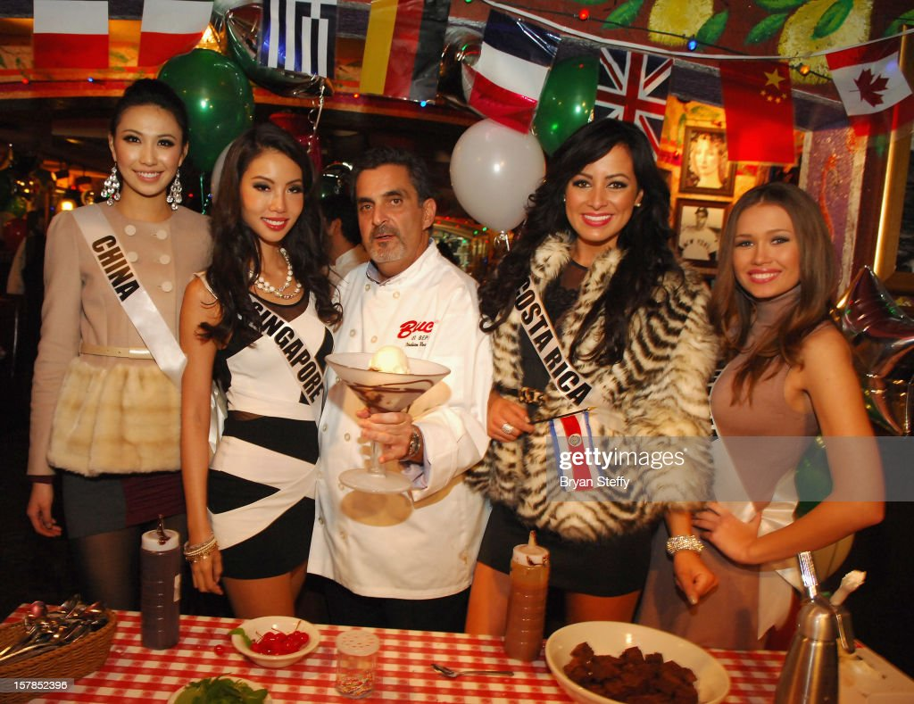 Miss China Ji Dan Xu, Miss Singapore Lynn Tan, Chef Stuart Leitner, Miss Costa Rica Nazareth Cascante and Miss Lithuania Greta Mikalauskyte appear at the Buca di Beppo Italian Restaurant on December 6, 2012 in Las Vegas, Nevada.