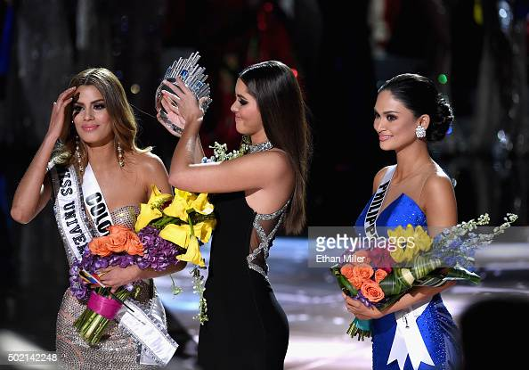Miss Colombia 2015 Ariadna Gutierrez Arevalo looks on as Miss Universe 2014 Paulina Vega removes her crown to give it to Miss Phillipines 2015 Pia...
