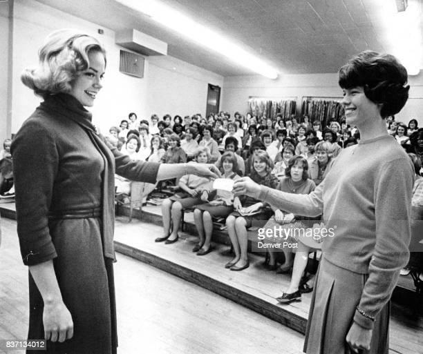 Miss Colorado Honored Miss Cheryl Sweeten Miss Colorado of 1963 is presented an honorary membership in the new YTeens Club at East High School by...