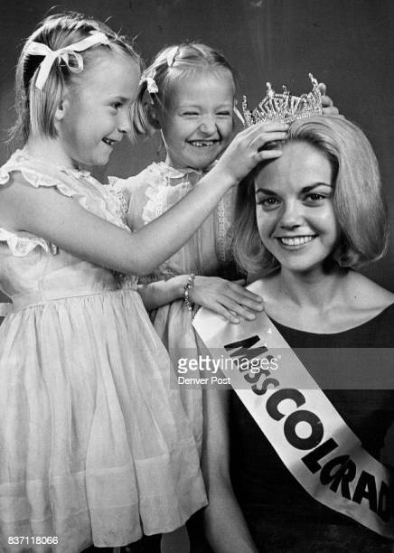 Miss Colorado's Smile Has Competition At Home Twins Marlayne and Michale admire sister Cheryl's newest crown Credit Denver Post