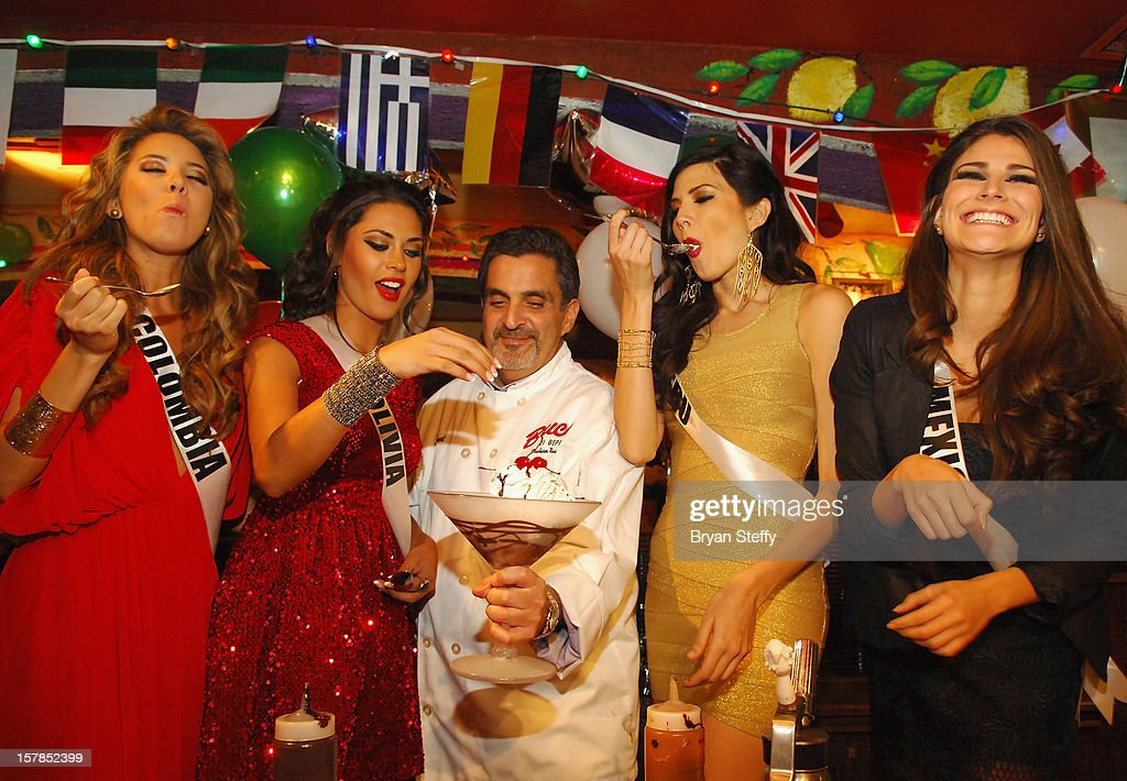 Miss Columbia Daniella Margarita Alvarez Vasquez, Miss Bolivia Yessica Mouton, Chef Stuart Leitner, Miss Peru Nicole Faveron and Miss Mexico Karina Gonzalez appear at the Buca di Beppo Italian Restaurant on December 6, 2012 in Las Vegas, Nevada.