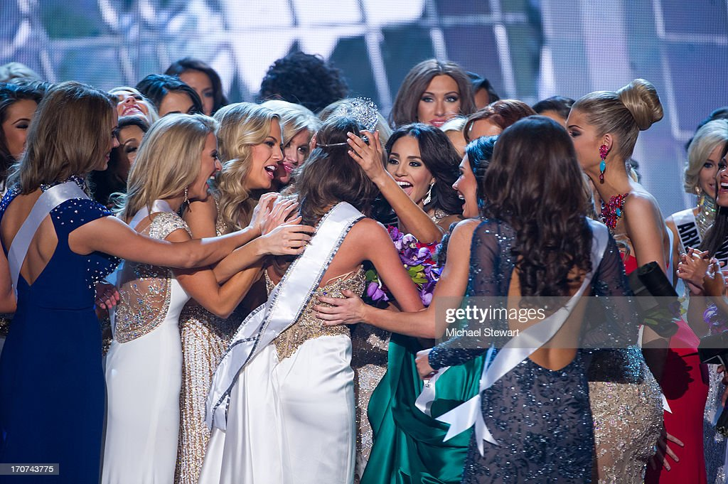 Miss Connecticut USA Erin Brady (C) congratulated by Miss USA contestants onstage after winning the 2013 Miss USA pageant at PH Live at Planet Hollywood Resort & Casino on June 16, 2013 in Las Vegas, Nevada.
