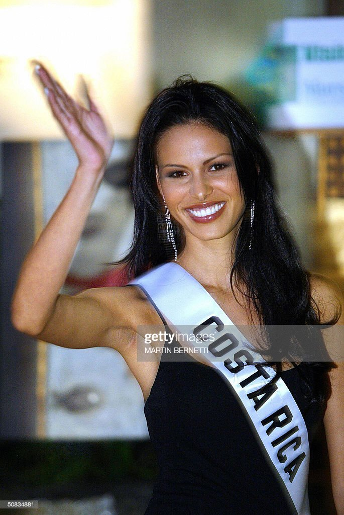 Miss Costa Rica Nancy Soto waves to photographers 13 May 2004 in Quito. The Miss Universe 2004 contest will take place 01 June 2004. AFP PHOTO/Martin BERNETTI