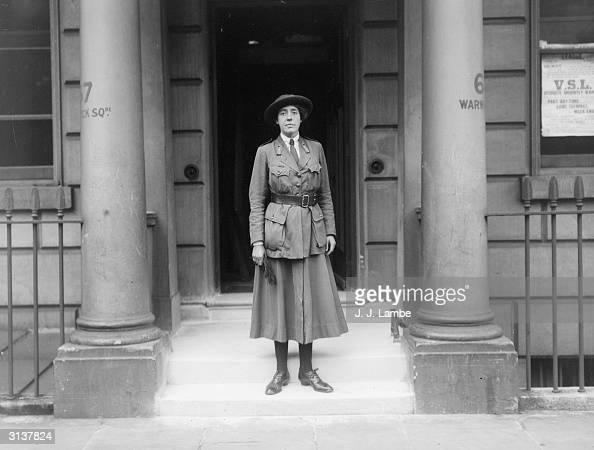 Miss D Milman of the Women's Service League outside 67 Warwick Square