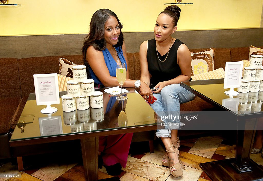 Miss Diddy (L) and Basketball Wives LA star Chantel Christie attend the Kinky-Curly 'Sneak Peek' event at the Four Seasons Hotel Los Angeles on April 30, 2014 in Beverly Hills, California.