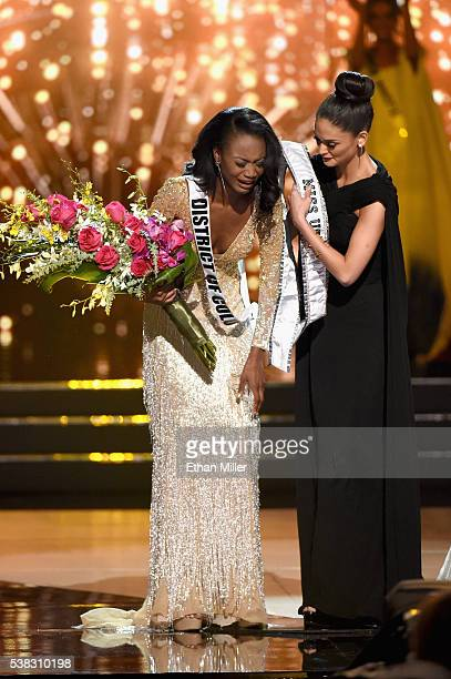 Miss District of Columbia USA 2016 Deshauna Barber reacts as Miss Universe 2015 Pia Alonzo Wurtzbach gives her the winner's sash after Barber was...