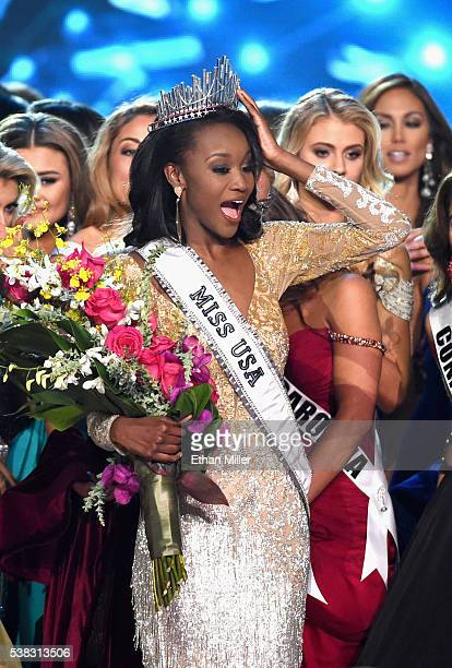 Miss District of Columbia USA 2016 Deshauna Barber reacts with the other contestants after being crowned Miss USA 2016 during the 2016 Miss USA...