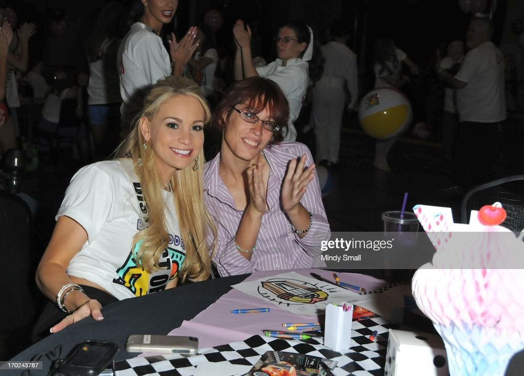 Miss District of Columbia USA Jessica Frith and a member of the Best Buddies organization appear during a sock hop at Planet Hollywood Resort & Casino on June 9, 2013 in Las Vegas, Nevada.