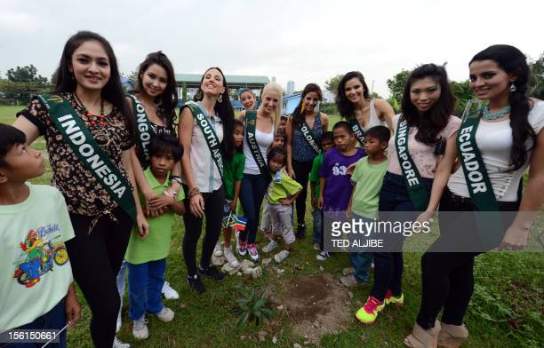 Miss Earth contestants Chelsy Liven of Indonesia Battsetseg Turbat of Mongolia Tamerin Michele Jardine of South Africa Jenna Seymour of Australia Lea...