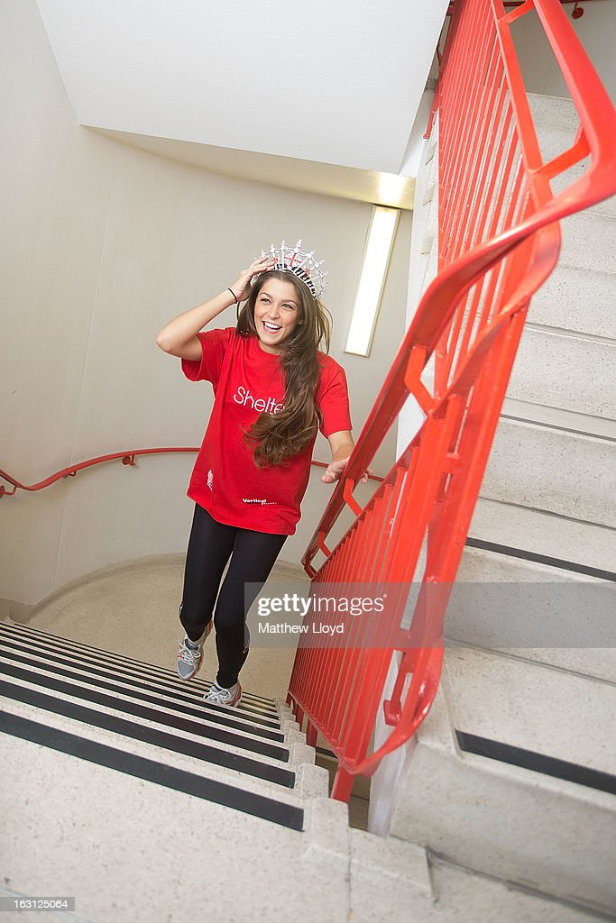 Miss England 2012, Charlotte Holmes, poses for photographs before taking part in the Vertical Rush event in the Tower 42 skyscraper on March 5, 2013 in London, England. More than a thousand members of the public will climb the 920 steps to raise money for the homelessness charity Shelter.
