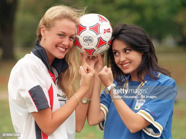 Miss England VickiLee Walberg goes headtohead with Miss Italy Irene Lippi near the FA headquarters in London today to show support for their national...