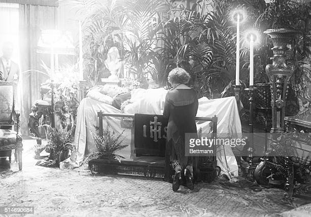 Miss Eva Miller at the coffin of Rudolph Valentino who is lying in state at Campbell's Funeral Parlor