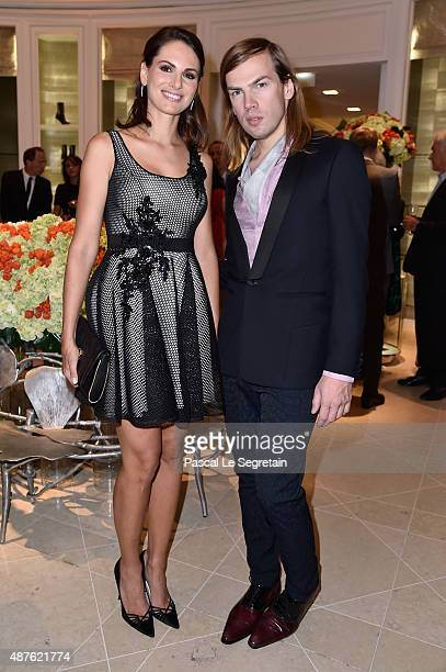 Miss France 2004 Laetitia Bleger and Fashion Designer Christophe Guillarme attend the 'Vendanges Montaigne 2015' at Dior at Avenue Montaigne on...