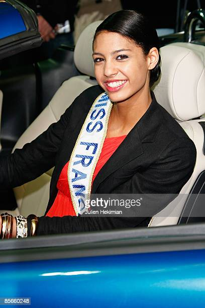 PARIS MARCH 27 Miss France 2009 Chloe Mortaud poses with her new car a '207 cabriolet' offer by Peugeot for her Miss France election at Parc des...