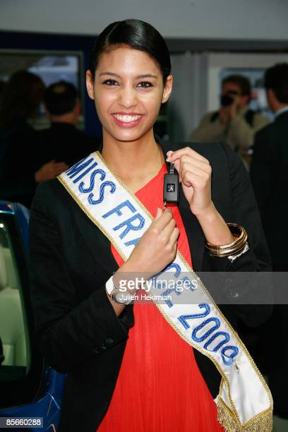 Miss France 2009 Chloe Mortaud poses with the key of her new car a '207 cabriolet' offer by Peugeot for her Miss France election at Parc des...