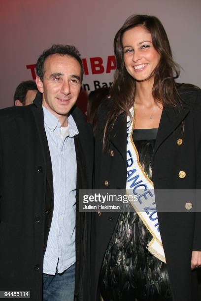 Miss France 2009 Malika Menard and Elie Semoun attend the Toshiba 'Go to Space' party at Palais De Tokyo on December 14 2009 in Paris France