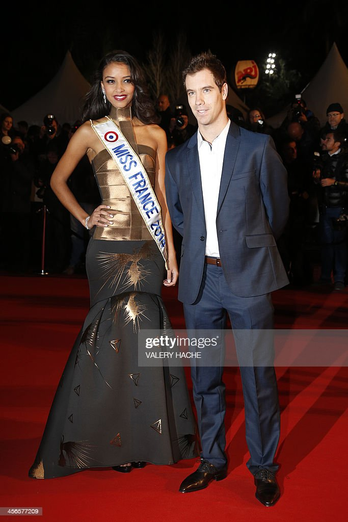 Miss France 2014 Flora Coquerel (L) and French tennis player Richard Gasquet arrive at the Palais des Festivals to attend the 15th Annual NRJ Music Awards on December 14, 2013 in Cannes, southeastern France.