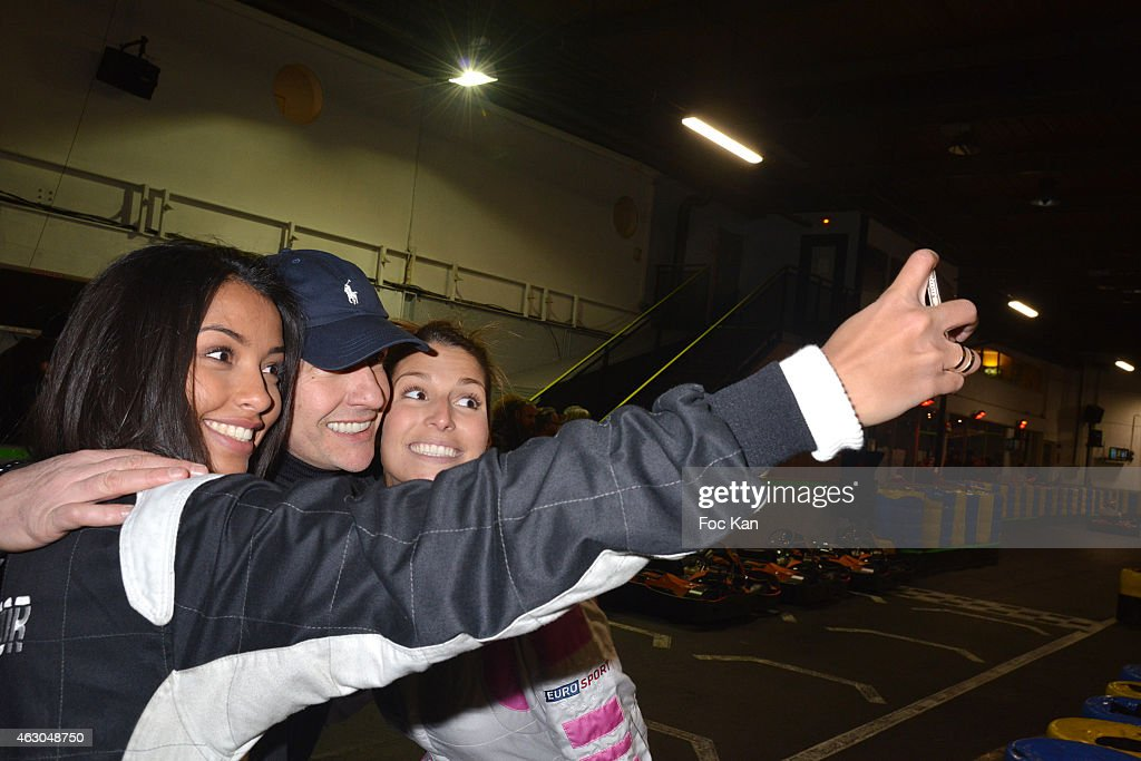 Miss France <a gi-track='captionPersonalityLinkClicked' href=/galleries/search?phrase=Flora+Coquerel&family=editorial&specificpeople=11782455 ng-click='$event.stopPropagation()'>Flora Coquerel</a>, Maxime and <a gi-track='captionPersonalityLinkClicked' href=/galleries/search?phrase=Laury+Thilleman&family=editorial&specificpeople=7372762 ng-click='$event.stopPropagation()'>Laury Thilleman</a> pose for a selfie during 'Une Course Pour La Vie' To Benefit Meghanora Children Care Association At Paris Kart Indoor of Wissous on February 8, 2015 in Paris, France.