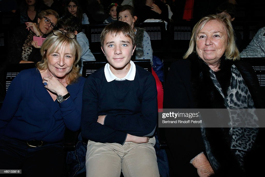 Miss Francois Pinault (Maryvonne) (R) with her daughter Florence Rogers (L) and her son Charles Rogers attend the Matinee 'Reve d'enfants' with Ballet 'Casse Noisette'. Organized by AROP at Opera Bastille on December 7, 2014 in Paris, France.
