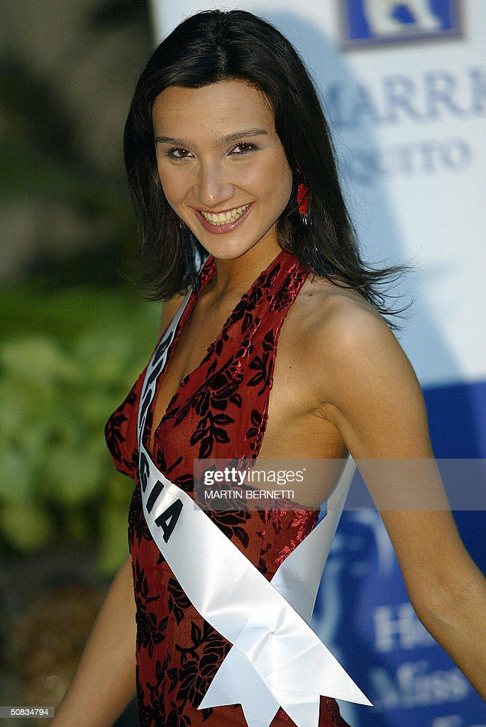 Miss Georgia Nina Murtazashvili poses to photographers 13 May 2004 in Quito. The Miss Universe 2004 contest will take place 01 June 2004. AFP PHOTO/Martin BERNETTI