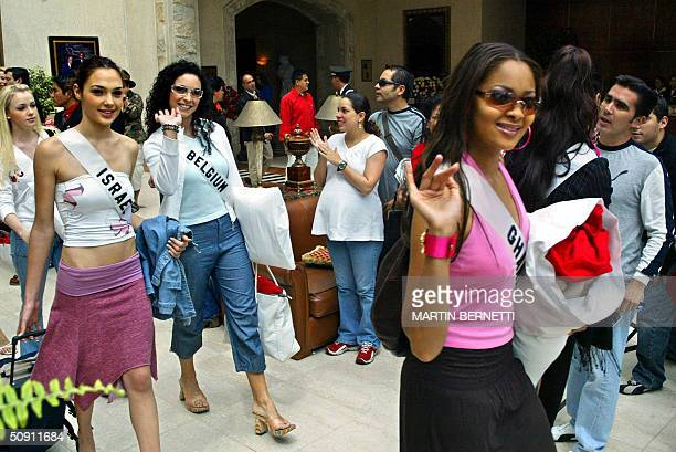 Miss Ghana Menaye Donkor Miss Belgium Lindsy Dehollander and Miss Israel Gal Gadot walk across the hotel hall 30 May 2004 in Quito Ecuador where the...