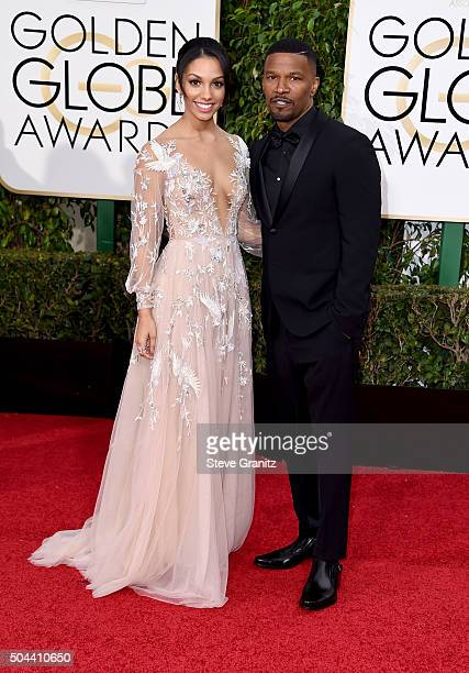 Miss Golden Globes 2016 Corinne Bishop and actor Jamie Foxx attend the 73rd Annual Golden Globe Awards held at the Beverly Hilton Hotel on January 10...