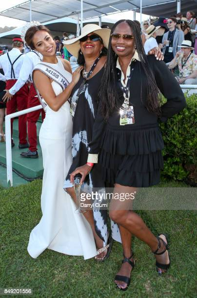 Miss Hawaii USA Julie Kuo poses for a photo with two spectators at the 2017 Hawaii Invitational of Polo on September 16 2017 in Waimanalo Hawaii