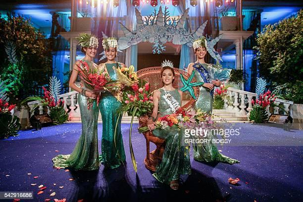 Miss Heiva Mehealani Tepou second placed Vaita Buisson Miss Tahiti 2016 Vaea Ferrand and third placed Vanille GuyotSionnest smile during the Miss...