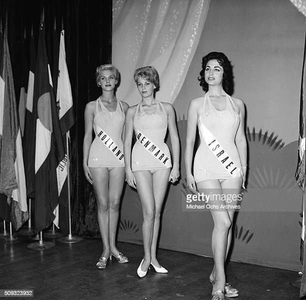 Miss Holland Corine Rottschafer Miss Denmark Evy Norlund and Miss Israel Miriam Hadar pose Geri Hoo Miss Universe Contestant poses during the contest...
