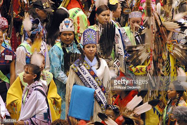 Miss Indian World 2002 Tia Smith a Cayuga/Iriquois of the Six Nations Reserve in Ontario Canada stands surrounded by other Native Americans during...