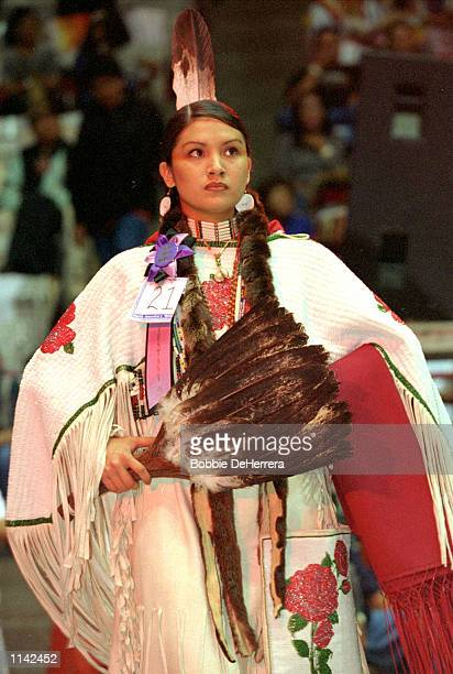 Miss Indian World contestant from one of more than 700 tribes from Canada and the United States stands at the 18th Annual Gathering of Nations Powwow...