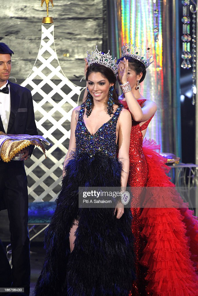 Miss International Queen 2013, Marcelo Ohio from Brazil receives the crown from last year's queen after winning the transvestite and transgender beauty pageant Miss International Queen 2013 at Tiffany's Show theatre in Pattaya city. Twenty-five contestants from 17 countries are participating in the event, which is endowed with prize money of 300,000 Thai baht (10,000 US dollars), a crown with real gems and a free surgery at a plastic surgery clinic in Bangkok..