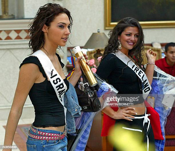 Miss Israel Gal Gadot and Miss Ireland Cathriona Duignam walks in the hall of a hotel in Quito City 19 May 2004 The Miss Universe 2004 contest will...