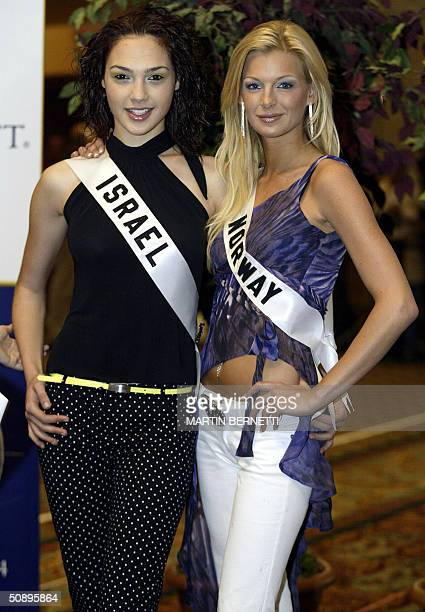Miss Israel Gal Gadot and Miss Norway Kathrine Sorland pose to photographers during an interview in Quito Ecuador 25 May 2004 The Miss Universe 2004...