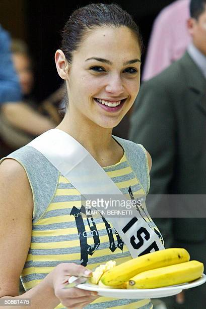 Miss Israel Gal Gadot smiles as she holds some bananas 20 May 2004 in Quito The Miss Universe 2004 contest will be held next 01 June in Ecuador AFP...