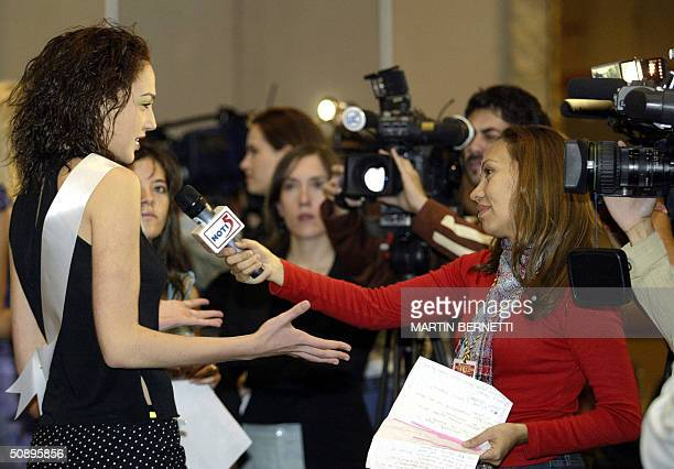 Miss Israel Gal Gadot talks with a reporter during an interview in Quito Ecuador 25 May 2004 The Miss Universe 2004 contest will take place in...