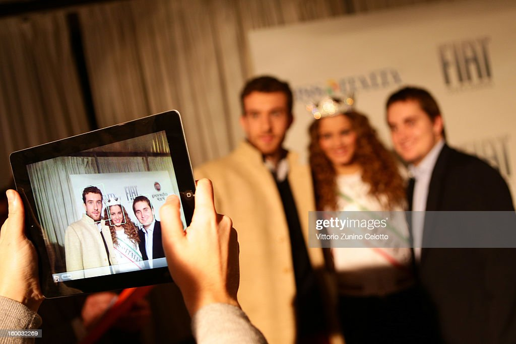 Miss Italia <a gi-track='captionPersonalityLinkClicked' href=/galleries/search?phrase=Giusy+Buscemi&family=editorial&specificpeople=9707519 ng-click='$event.stopPropagation()'>Giusy Buscemi</a> poses with fans during FIAT Panda 4x4 event at the FIAT Open Lounge on January 24, 2013 in Milan, Italy.
