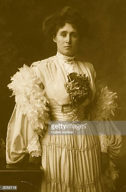 Miss Jameson wearing an Edwardian dress with full sleeves a corsage and a feather boa