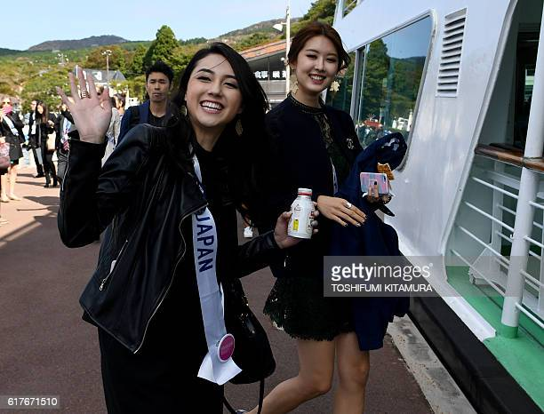 Miss Japan Junna Yamagata and Miss Korea Kim MinJeong pose while boarding the boat at Lake Ashinoko in Hakone Kanagawa prefecture on October 24 2016...