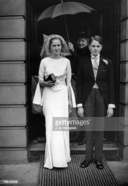 Miss Laura Herbert leaves her London home with her teenaged brother Auberon for her wedding to writer Evelyn Waugh 17th April 1937 The wedding took...