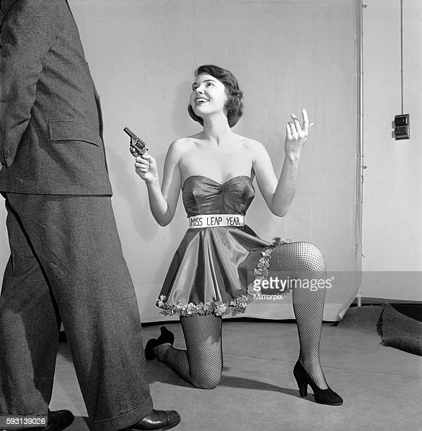 Belinda Penelope seen here proposing to boyfriend holding a gun February 1964