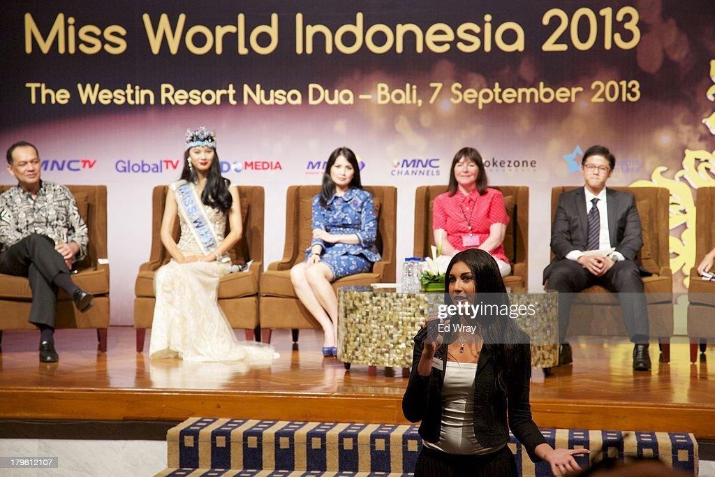 Miss Lebanon answers a question at the opening press conference during the 2013 Miss World Pageant on September 7, 2013 in Denpasar, Bali, Indonesia. The Miss World contest has been protested by conservative Indonesian Muslim groups who object particularly to the Bikini swimwear portion of the competition which organizers have agreed to replace this year with a more modest beachwear competition including tradtional Indonesian batik sarongs.