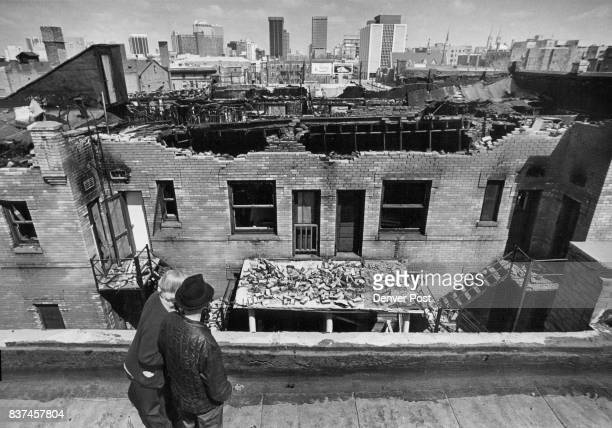 Miss Leona Ruff And George Schwerer Look over Damage Done In Fire At Bon Air Apartments They are standing on the roof of the Lincoln Apartments where...