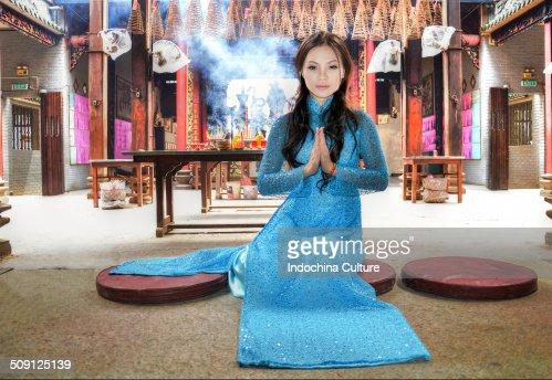 Miss Long Dress praying in pagoda