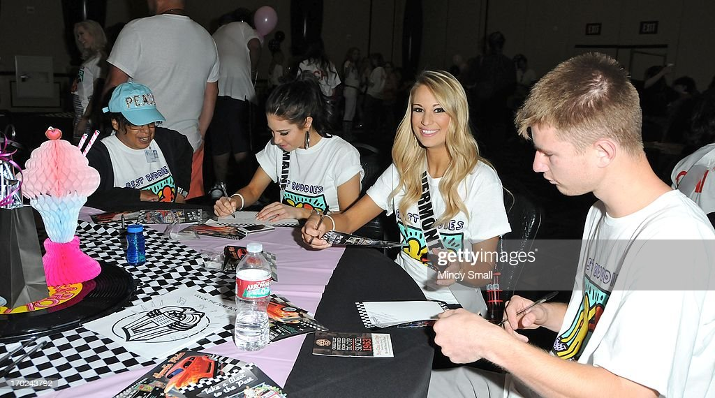 Miss Maine USA Ali Clair and Miss Vermont USA Sarah Westbrook and members of the Best Buddies organization attend a sock hop at Planet Hollywood Resort & Casino on June 9, 2013 in Las Vegas, Nevada.