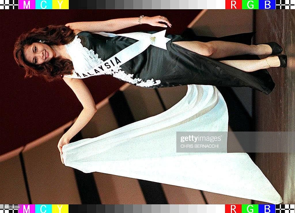 Miss Malaysia Trincy Low models her evening gown during rehearsals for the Miss Universe pageant 11 May at the Miami Beach Convention Center, Florida. The pageant will be held 16 May.