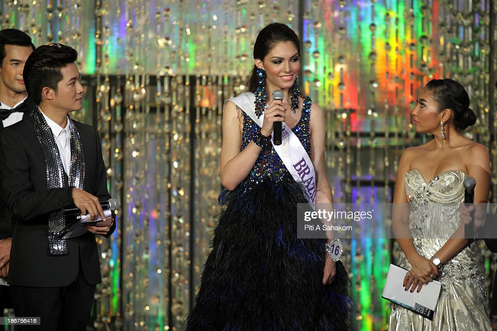 Miss Marcela Ohio from Brazil during answering question from committees in the transvestite and transgender beauty pageant Miss International Queen 2013 at Tiffany's Show theatre in Pattaya city. Twenty-five contestants from 17 countries are participating in the event, which is endowed with prize money of 300,000 Thai baht (10,000 US dollars), a crown with real gems and a free surgery at a plastic surgery clinic in Bangkok..