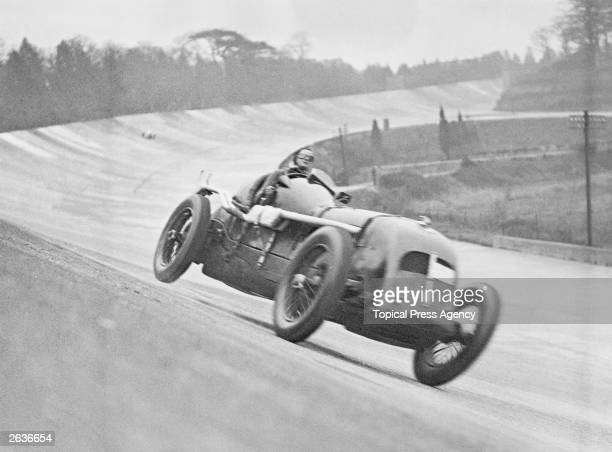 Miss Margaret Allan driving Richard Marker's Bentley during a practice run at Brooklands racetrack Surrey