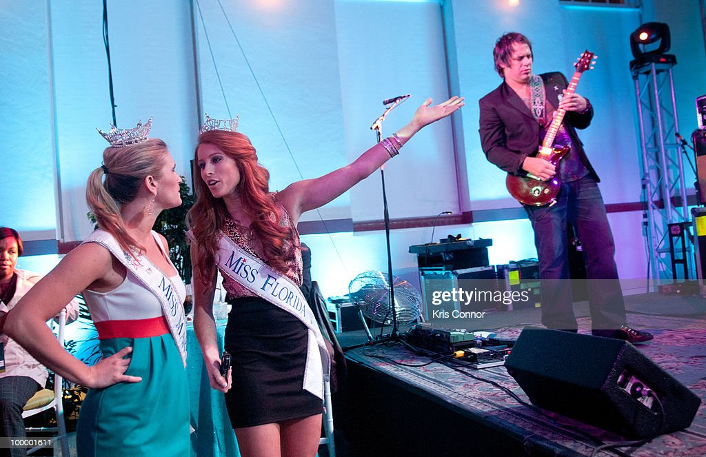 Miss Maryland Brooke Poklemba (L) and Miss Florida Rachael Todd watch Blues Traveler perform during the America's Everglades Summit to Unite Conservation celebration at Eastern Market on May 19, 2010 in Washington, DC.